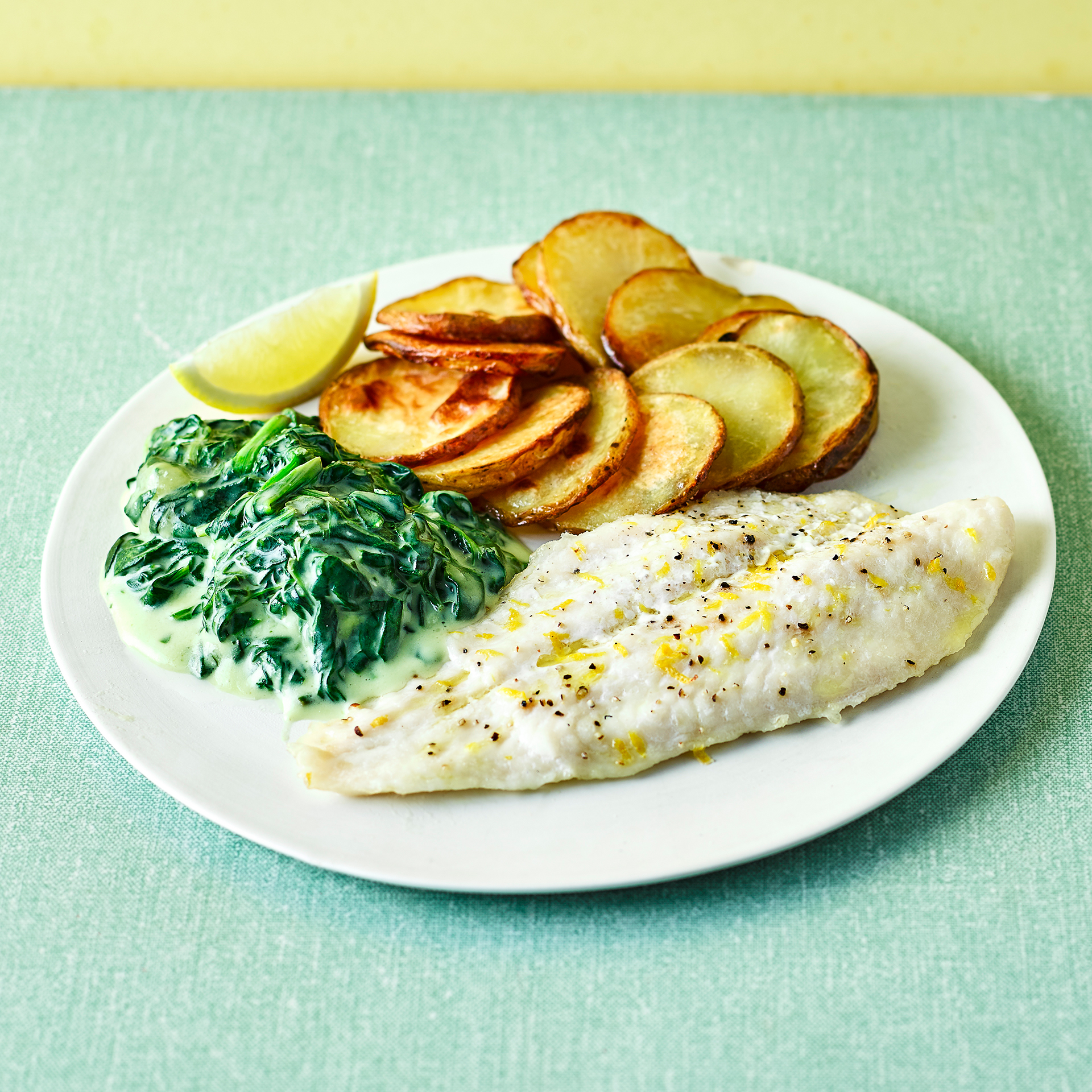 Lemon baked fish with spinach mornay recipe gousto for Lemon fish recipe